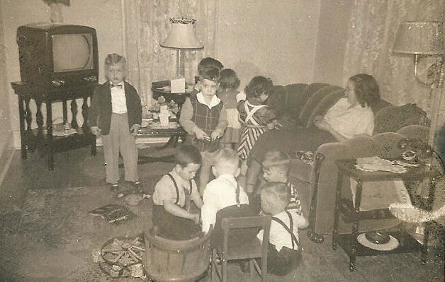 Here are my friends and me having 'facetime'.  Wii was just 'we' back then, chatting with each other, by using our voices.  Notice our old phone on it's stand and the television is OFF.